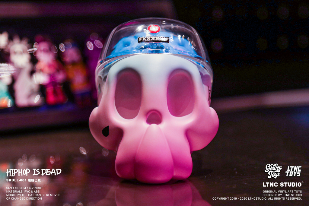 Blue and pink skull toy placed on surface