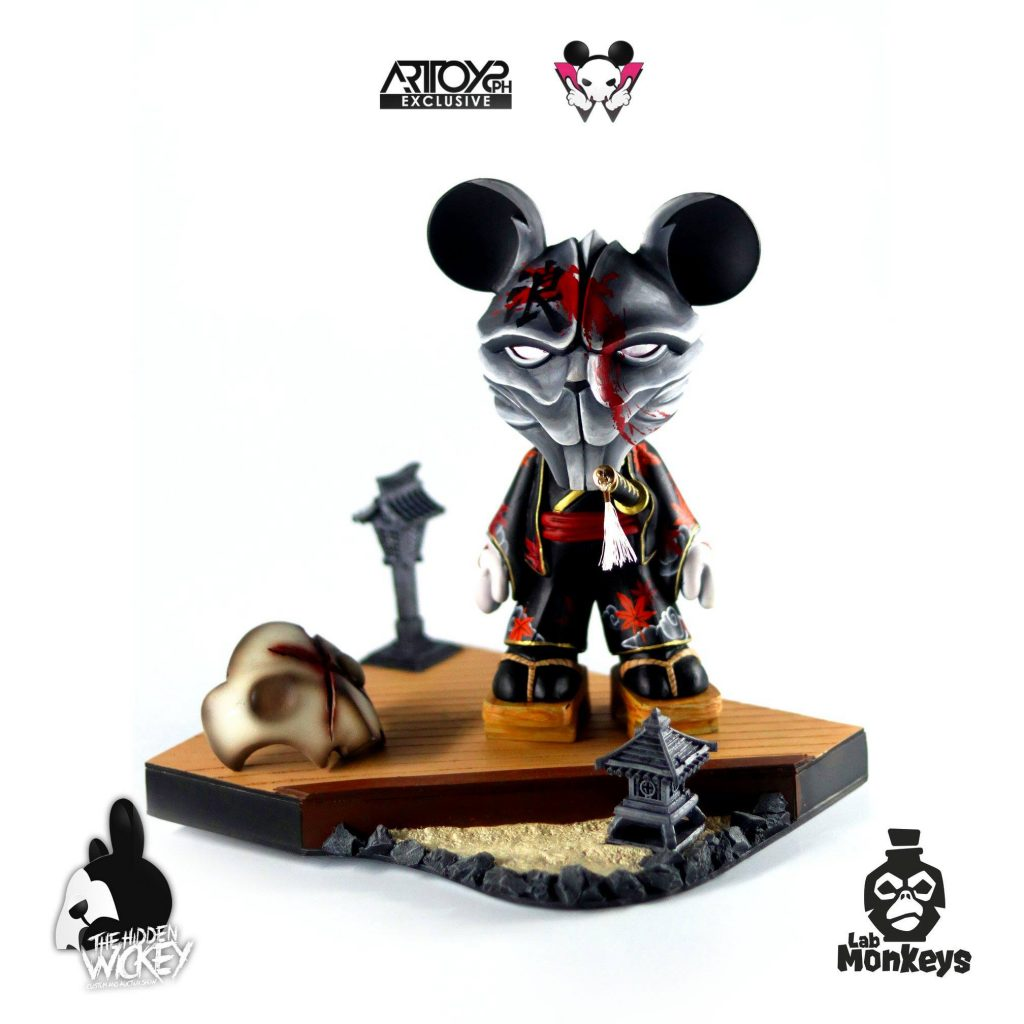 A samurai style rat custom toy with a wooden stand