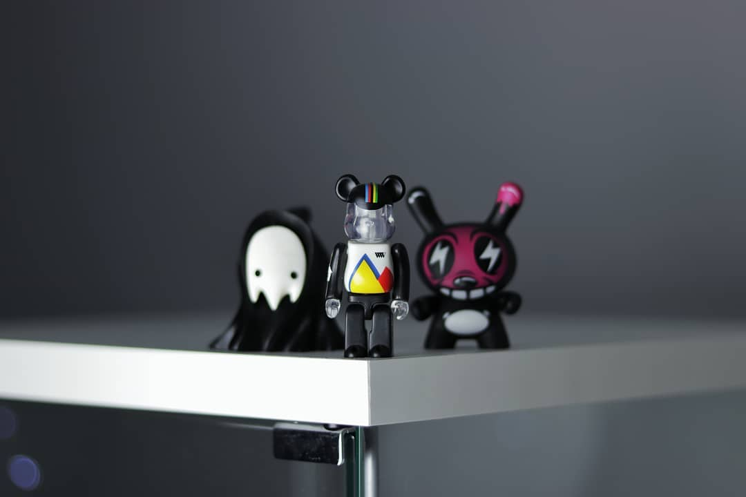 bearbrick grumreaper and dunny standing on a shelf