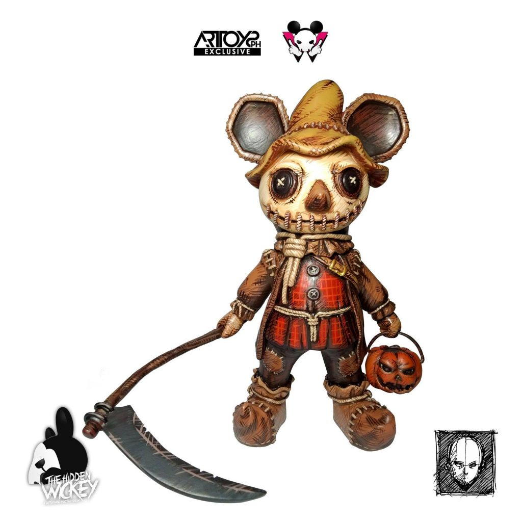 A scarecrow style rat toy with a pumpkin lantern and scythe
