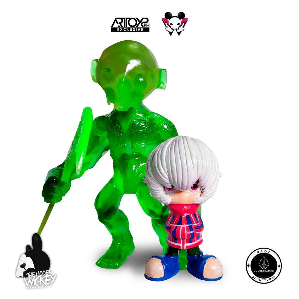 A green form toy with a smaller human with white hair