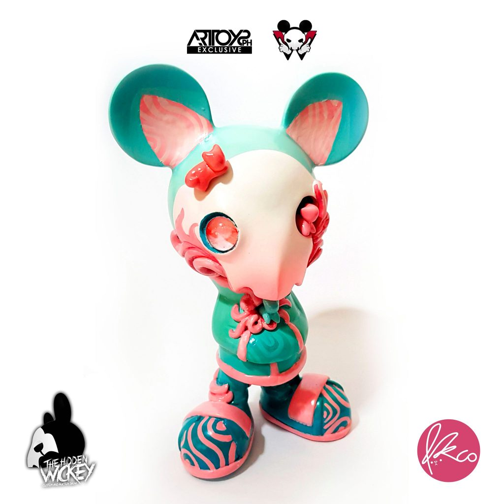 A pastel pink and blue rat custom toy