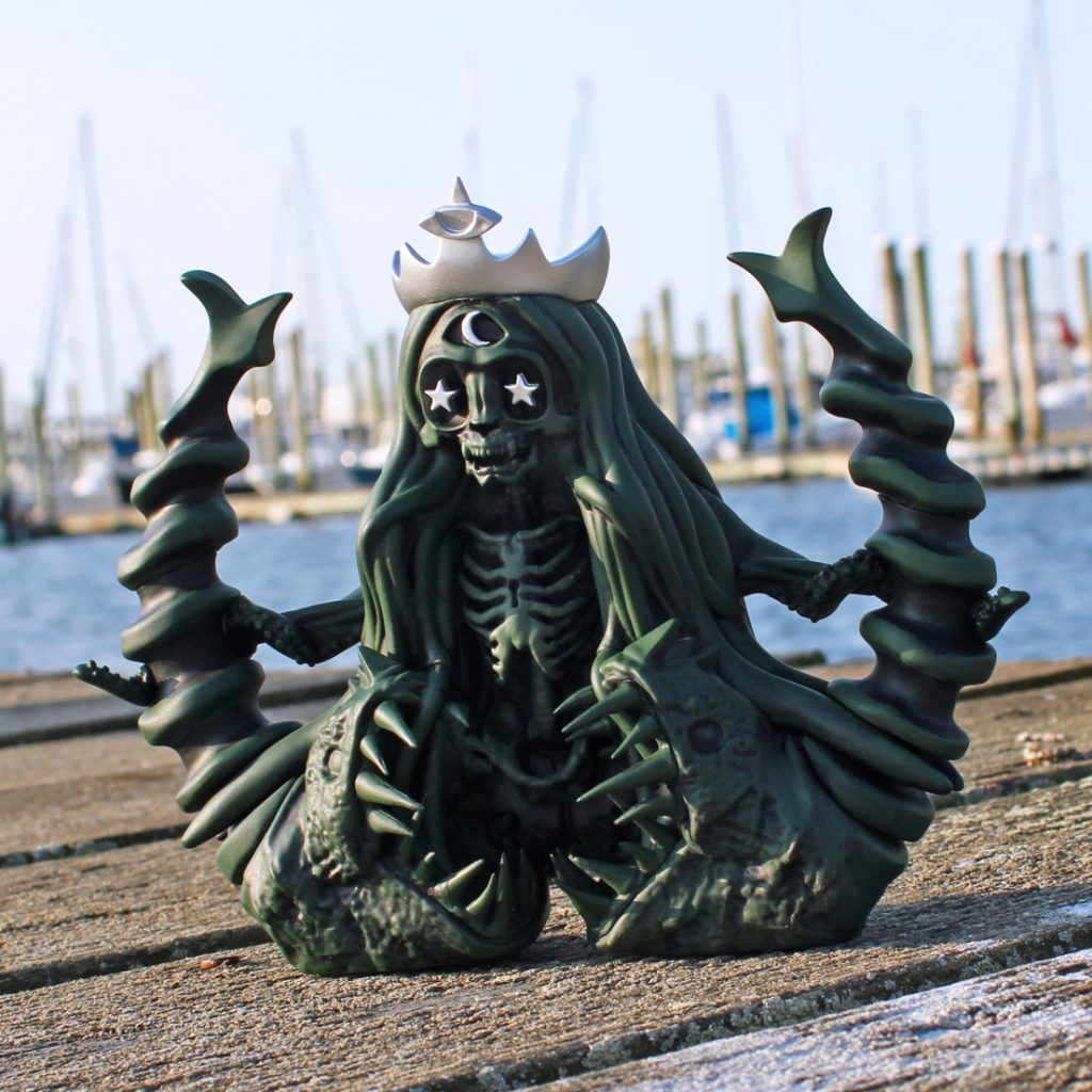 Slave to the Siren on a dock in front of boats and water