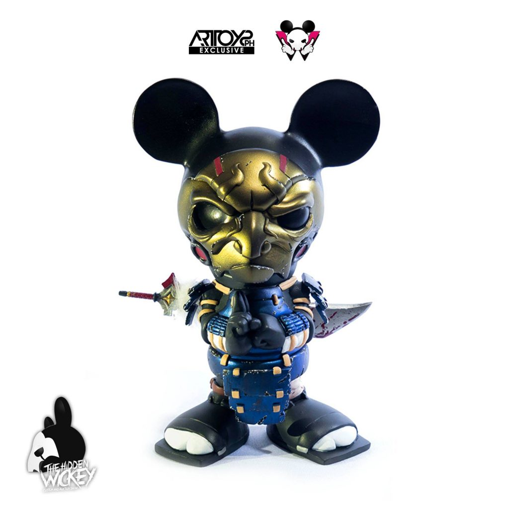 A samurai looking rat toy wearing a gold mask