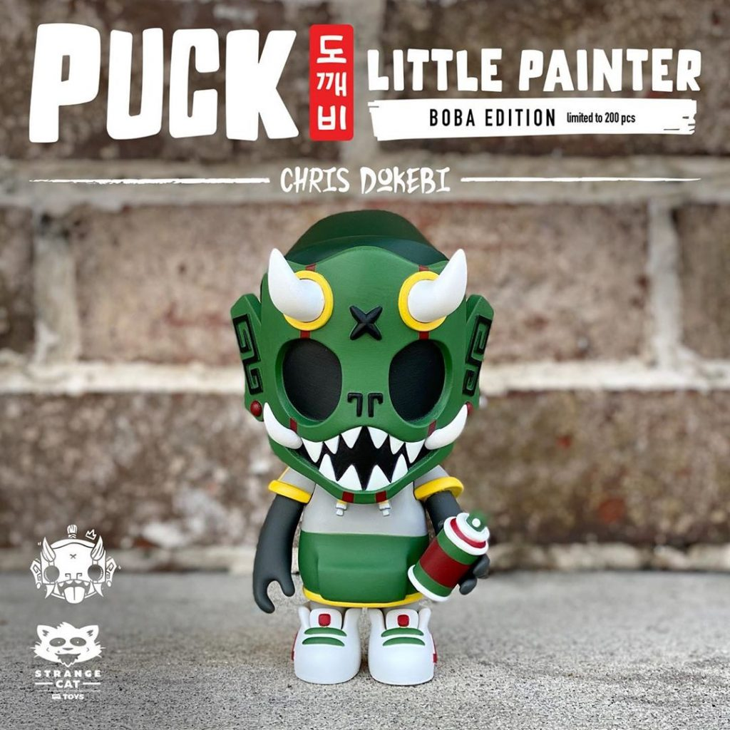 chris dokebi puck little painter boba edition in front of brick wall