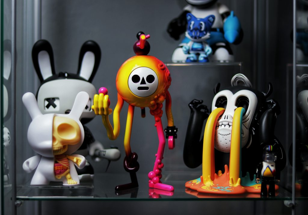 pluteus and other toys in the glass toy collection display