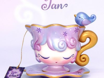 Dressy Doll's Lady Jan teacup toy with a small bird