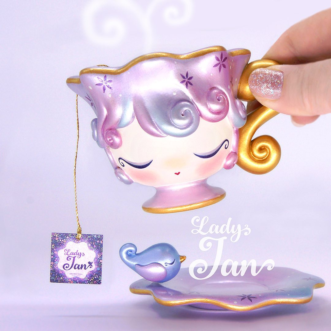 Dressy Doll's Lady Jan teacup toy being held up