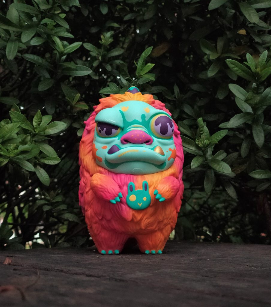 A brightly colored monster toy with a furry coat
