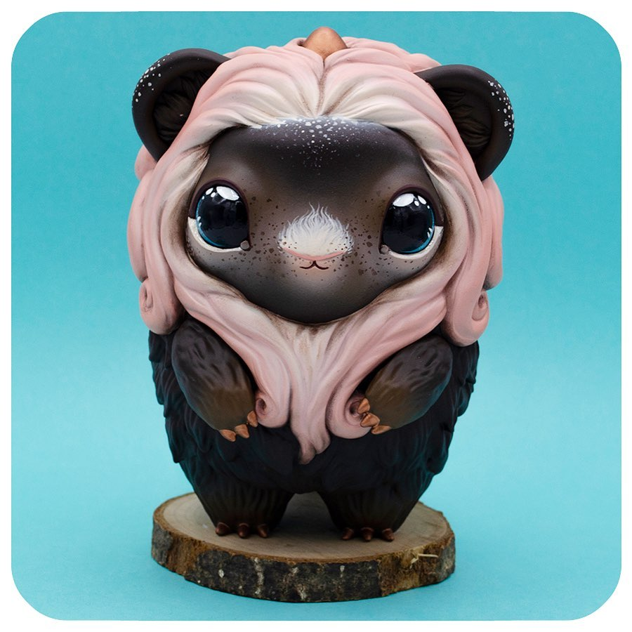 A cute looking furry brown monster toy with pink hair