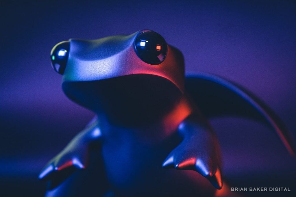 apo newt statue lit purple and red