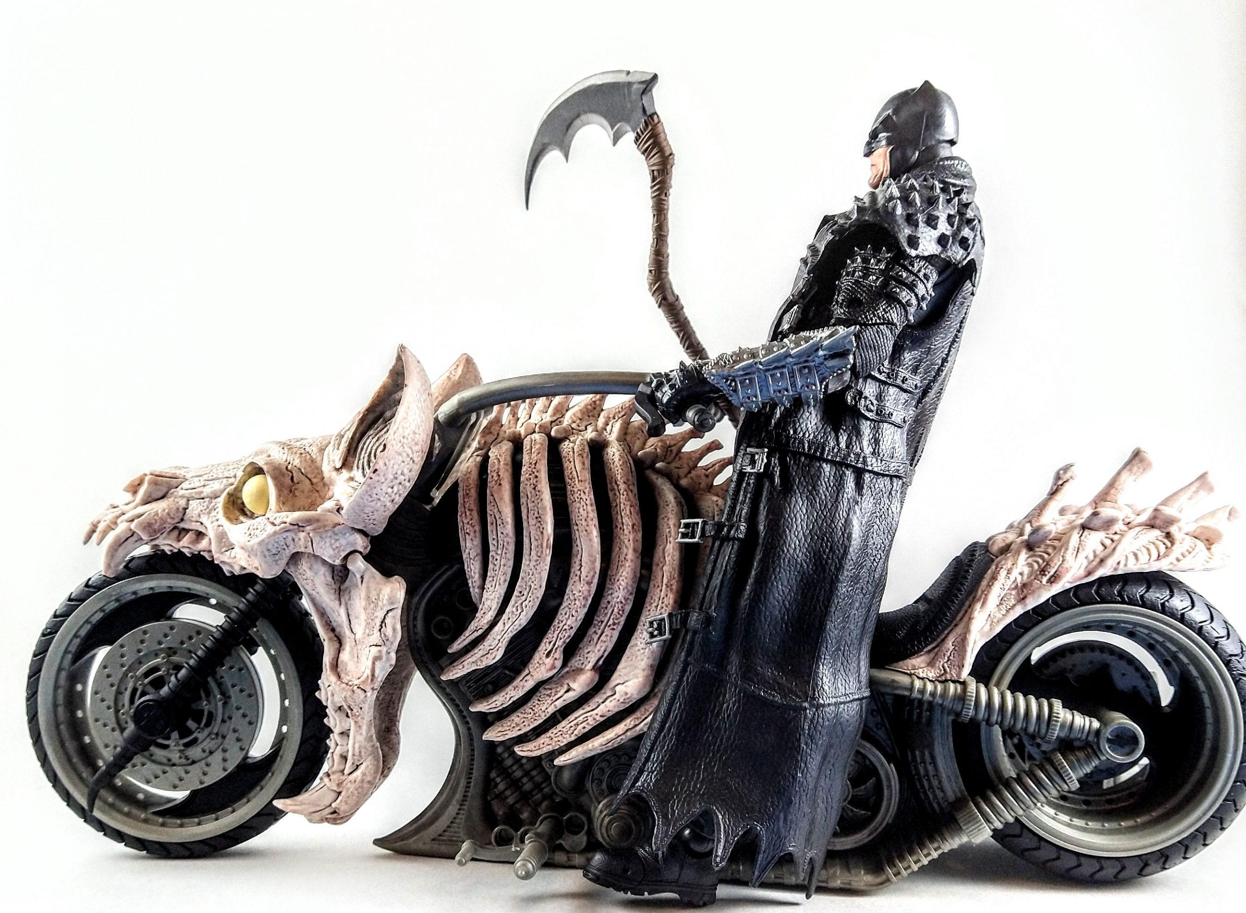 Profile view of Death Metal Batman on the Batcycle